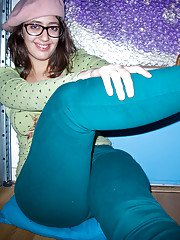 Young fatty Ariel D poses in glasses while flashing large natural tits