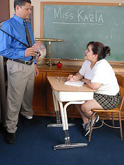 Fat schoolgirl Karla gives her dominant teacher a handjob in class