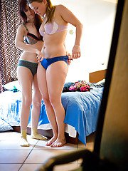 Gay amateurs Alyssa and Gisela helping one another get dressed