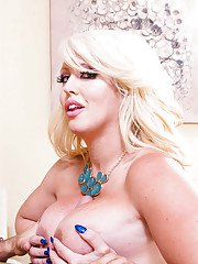 Blonde BBW Alura Jensen with cum dripping off face after giving blowjob