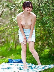 Hairy Asian amateur Gita slowly taking off her clothes outdoors