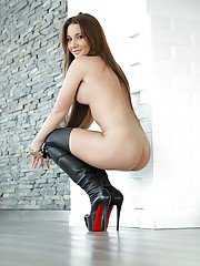 Stunning brunette Julie Skyhigh posing in high heel boots and spreading