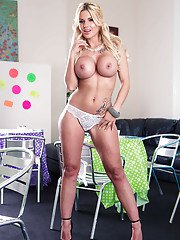 Beautiful blonde babe Candy Sexton playing with her big boobs in heels