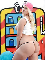 Big butt pornstar Lucky B showing off tattoos and that sexy big booty