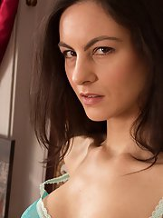Buxom housewife Michelle Khan poses fully clothed and in the nude