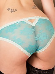 Brunette wife Michelle Khan spreads nylon covered legs to flash panties