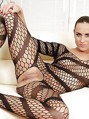 Hot Euro model Mea Malone posing solo in mesh bodysuit and high heels