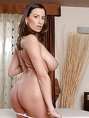 Busty housewife Sensual Jane opens bath robe and displays huge natural tits