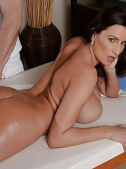Curvy mom Sensual Jane has her large natural breasts oiled and massaged
