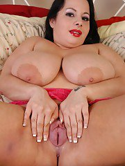 Huge chested lady Devyn masturbating shaved cunt with large glass dildo