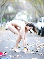 Adorable brunette babe Darya showing off her hairy cunt outdoors