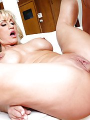 Experienced blonde lady Ryan Conner takes a long cock up shaved snatch