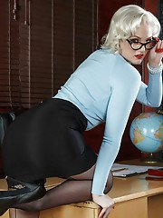 Platinum blond Jenna Ivory strips off her business clothes at the office