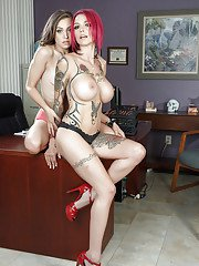 Tattooed redhead domme plays with her young lesbian sex toy