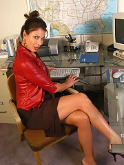 Big arsed office worker Vanessa taking off leather jacket and dress at work