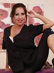 Mature Latina massage worker exposes her large natural breasts