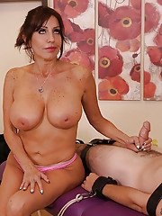 Busty Latina cougar gives young stud a cock jerking he wont forget