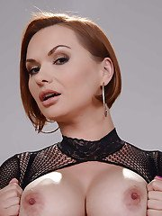 Short haired MILF Katja Kassin models sexy fishnet bodystocking