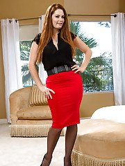 Solo model Allison Moore posing fully clothed in hot red skirt and heels