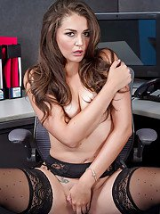 Petite secretary Allie Haze poses in black underwear and stockings