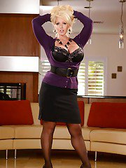 Top heavy blonde Alura Jensen flaunting her huge juggs fully clothed