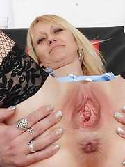 Mature nurse Nelly stripping off uniform and masturbating shaved pussy