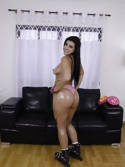 Busty Brazilian babe Aline Rios pulling down spandex shorts over big booty