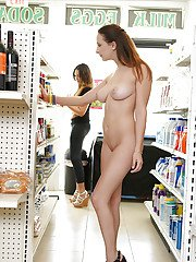 Barely legal amateur Ashley Adams flashing big natural tits inside a store