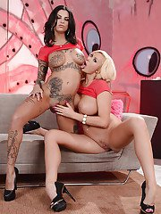 Busty models Bonnie Rotten and Summer Brielle exposing huge juggs