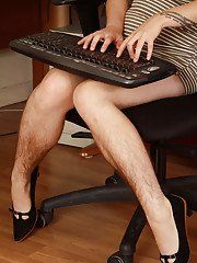 Mature redhead secretary Velma displays her hairy everything at work