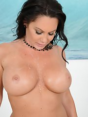 Curvy brunette Daytona Rains having her big juggs oiled and massaged