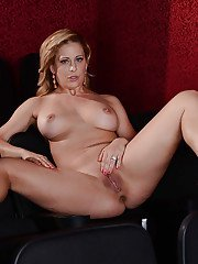 Outstanding blonde MILF Cherie Deville playing with her big boobs