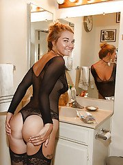 Gorgeous blonde teen Lily Ivy showing off her ass in lingerie