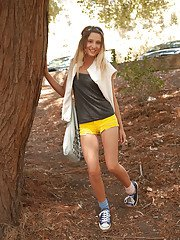 Desirable young blonde Charli Romano having fun in yellow shorts