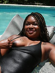 Luscious Ebony babe Diamond showing off her fat booty in a pool