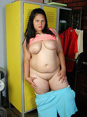 Fat mature brunette Nancy spreading her shaved pussy in a locker room