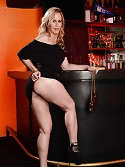 Glorious blonde MILF Simone Sonay rubbing her cunt on a bar stool