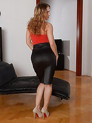 Office worker Sabrina Moore posing fully clothed in business outfit