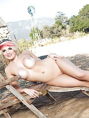 Centerfold model Sarah Louise Harris modelling outdoors in sunglasses