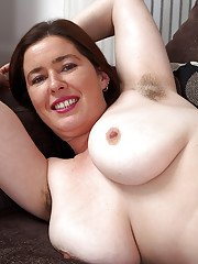 Experienced lady Janey lets pubic hairs peek out from under white panties