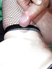 Mature woman in fishnet stockings and black boots receives oral sex outside