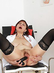 Over 50 nurse Remy spreading stocking clad legs for finger fucking of bush