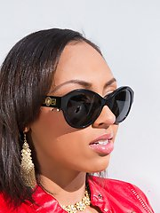 Busty ebony teen Cherry Hilson posing in red leather jacket and sunglasses