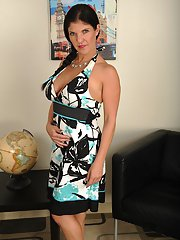 Busty brunette MILF Coralyn Jewel removing dress for naked solo posing