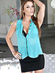 Slender teen pornstar Dillion Carter posing fully clothed before stripping
