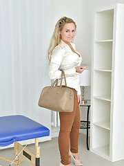 Blonde over 30 MILF Barra Brass posing fully clothed before stripping naked