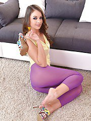 Top Euro babe Angelina Brill striking sexy solo poses in purple nylons