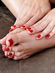 Blonde mom Zoey Tyler displaying her brightly painted toenails