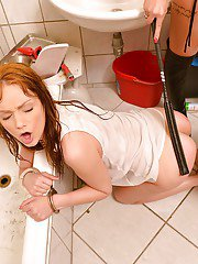 Redheads Aylin Diamond and Sophie Lynx engage in BDSM sex in bathroom