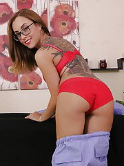 Busty chick in glasses gets undressed to reveal nice natural rack